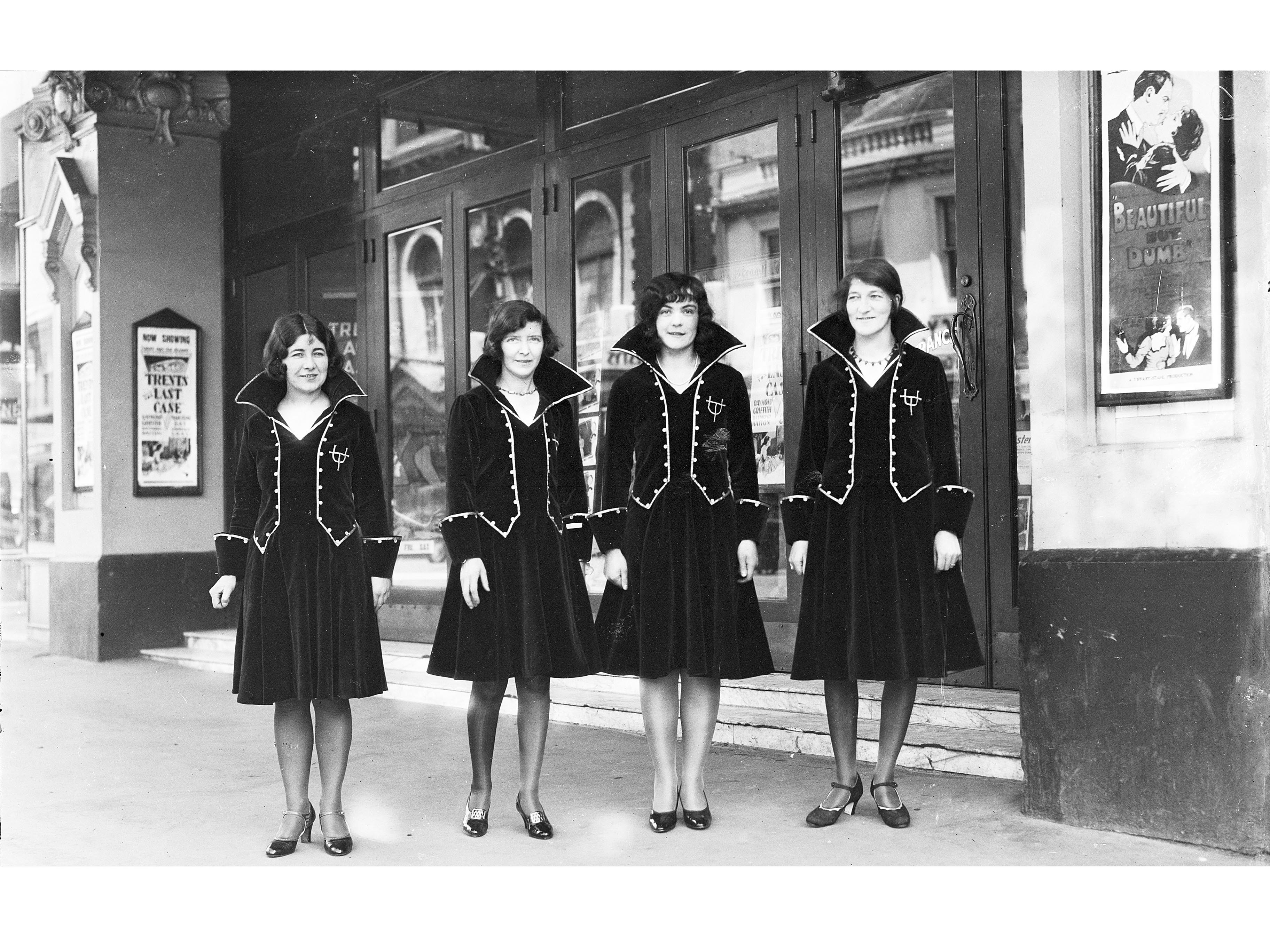 Usherettes standing in the doorway of the New Strand Theatre, Liverpool Street, Hobart (1930)