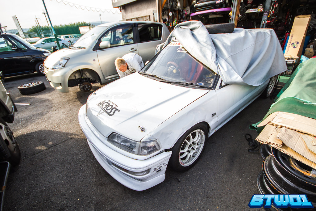 white car half covered