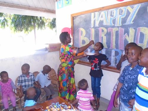 Mama Tuta feeds Annie Njeri some cake