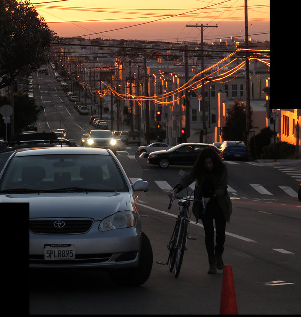 Maite with bicycle on Kirkham St at sunset; The Sunset, San Francisco (2015)