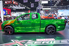 Metallic green high-reflective Isuzu X-Series pickup truck at the 36th Bangkok International Motor Show