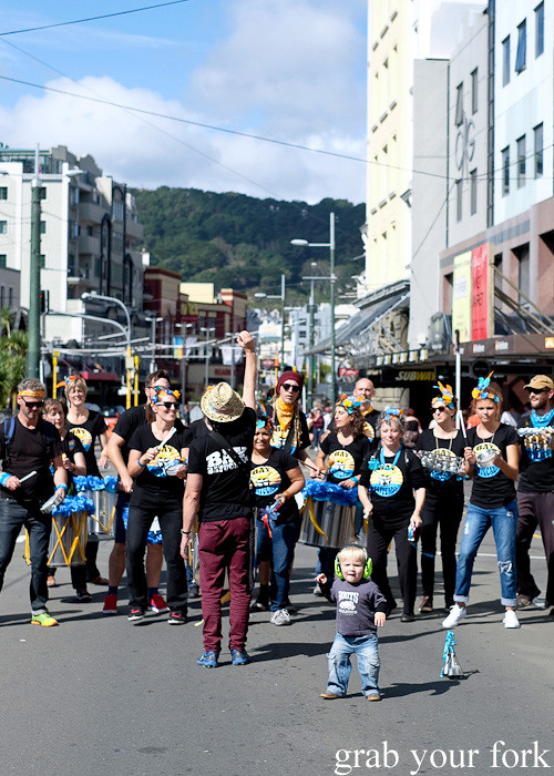Batucada parade against a backdrop of Wellington at the Cuba Dupa Festival 2015