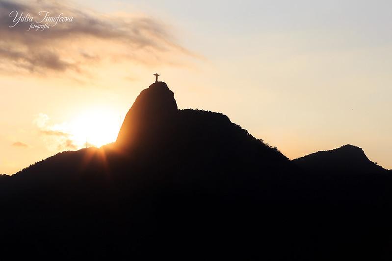 Sunset behind  Mountain Corcovado Christ the Redeemer, Rio de Janeiro