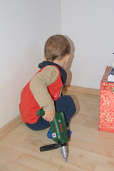 footwear(0.0), toddler(0.0), child(1.0), floor(1.0), art(1.0), play(1.0), cleanliness(1.0), flooring(1.0),