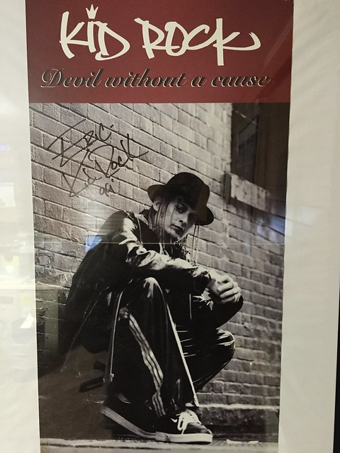 Kid Rock autographed poster from the House of Guitars, March 21, 1999