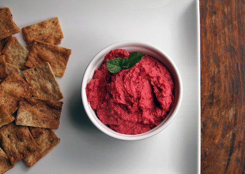roasted beet hummus with mint garnish