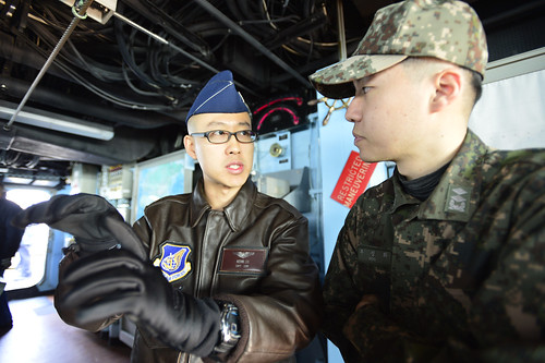 WATERS TO THE WEST OF THE KOREAN PENINSULA - U.S. Air Force Capt. Kevin Liu, from the 621st Air Control Squadron, discusses operations with Republic of Korea Navy Lt. j.g. Woo Sung Hwa while underway aboard the guided-missile destroyer USS John S. McCain (DDG 56) during exercise Foal Eagle 2015.