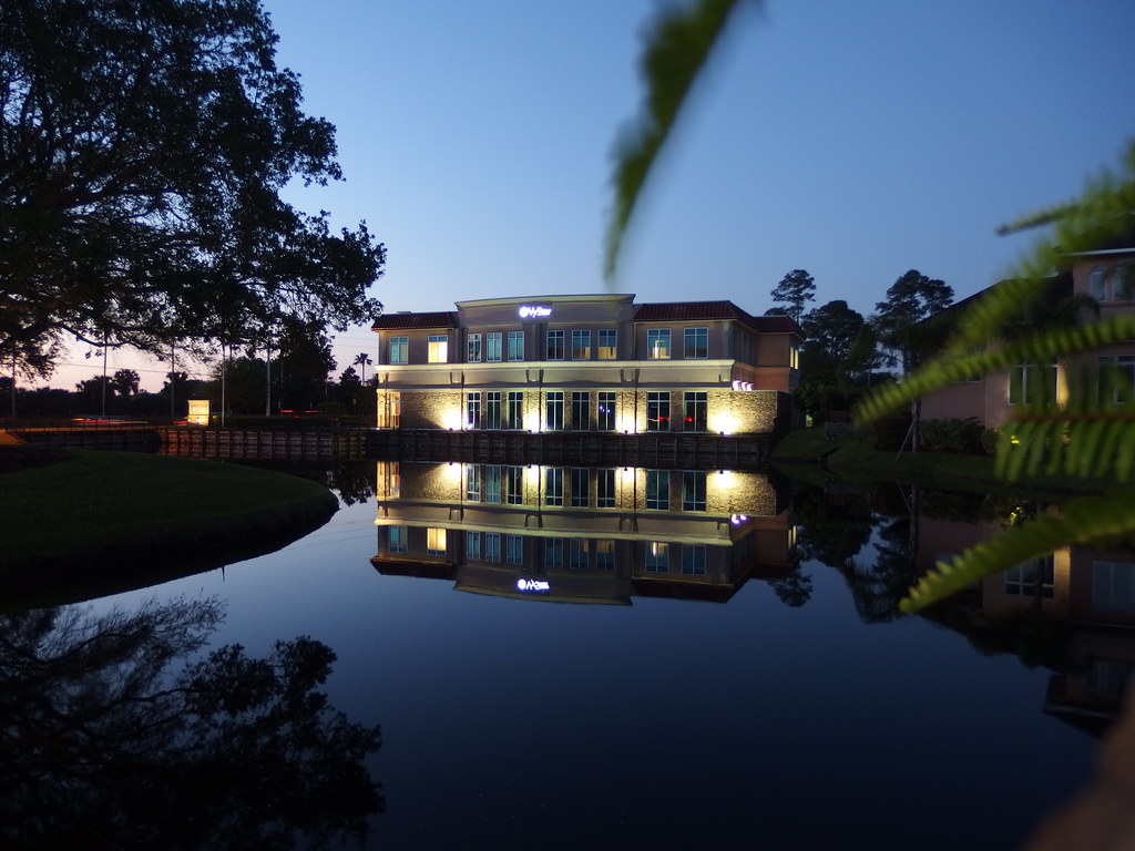 Picture of a building reflected in a pond taken before dawn on an Olympus XZ-10