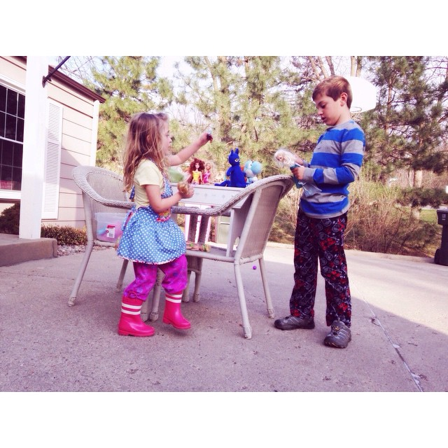 They are both wearing pj pants playing with dolls in the driveway #missz #owenchristopher #bigbro #littlesis #hedoeslikeher #notfighting