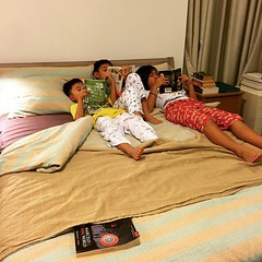 So yeah. We fixed the guest room bed, inflated the air bed and ended up here. Reading and separation anxiety. It runs in the family. #singapore #springbreak2015