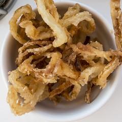 meal(0.0), vegetable(0.0), fish(0.0), vegetarian food(0.0), produce(0.0), junk food(1.0), fried food(1.0), onion ring(1.0), food(1.0), dish(1.0), cuisine(1.0), snack food(1.0), tempura(1.0),