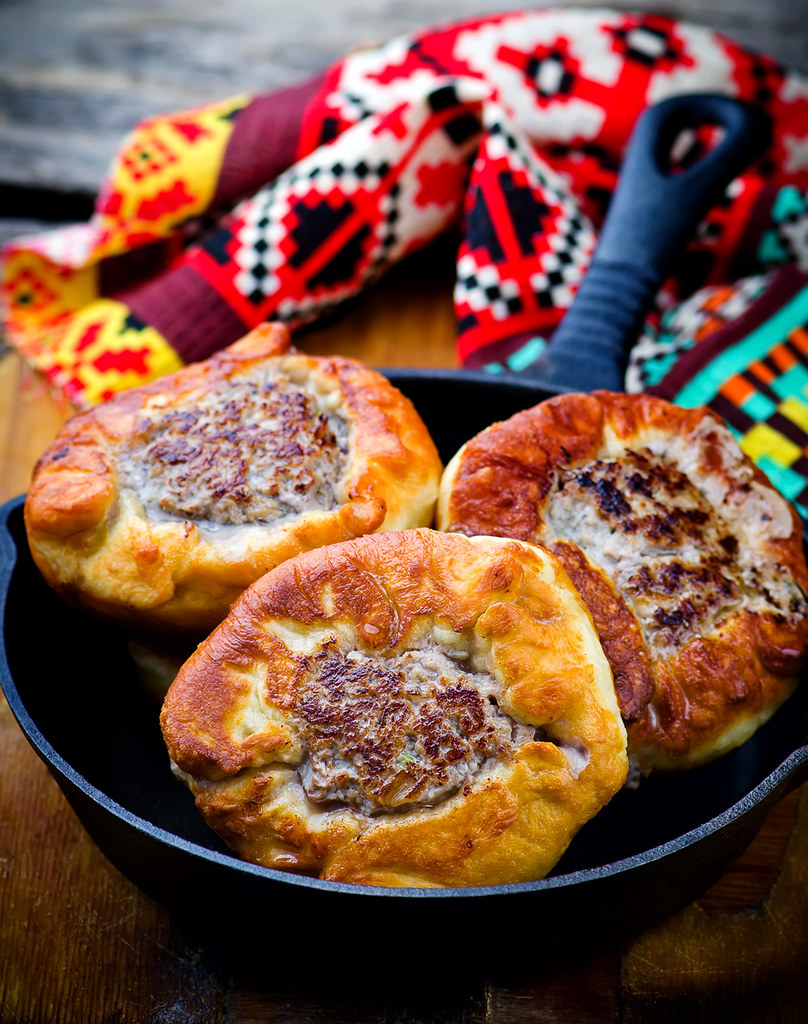 belyash ,yeast dough round pasty with meat filling .