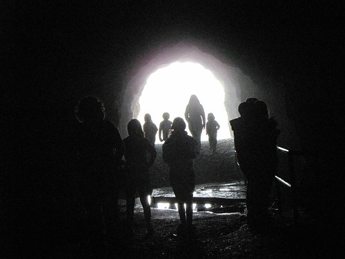 People Silhouettes in a Cave