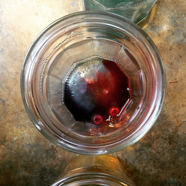 Maddy dropped 2 tablets into the same glass jar, so she's gonna get a red-purple. (Yeah, we're using a Paas kit...next year, we'll do the natural dye thing, I think!)