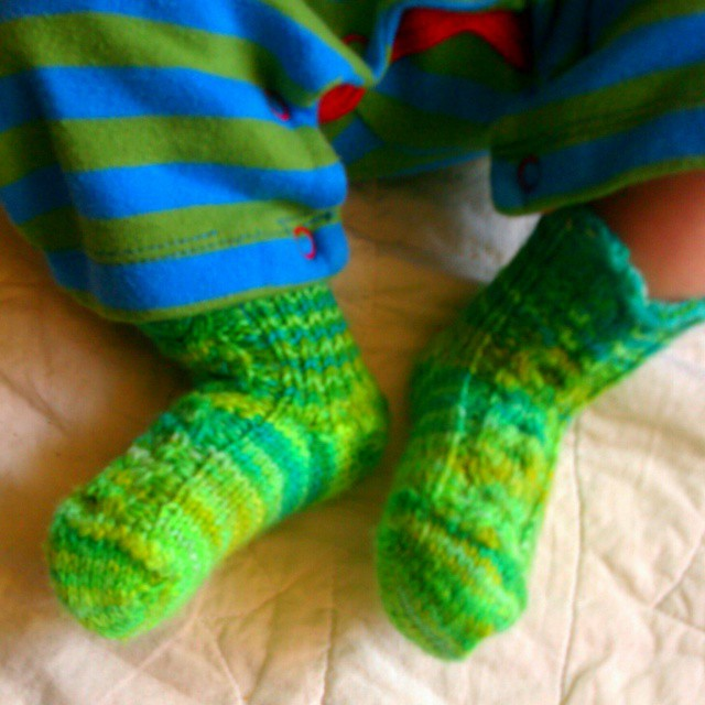 Tiny socks for tiny feet, knit from yarn I handpainted (these are still a bit big, but I thought he wasn't going to fit into them for at least a year). #knitting #babyDWood #madeforkids