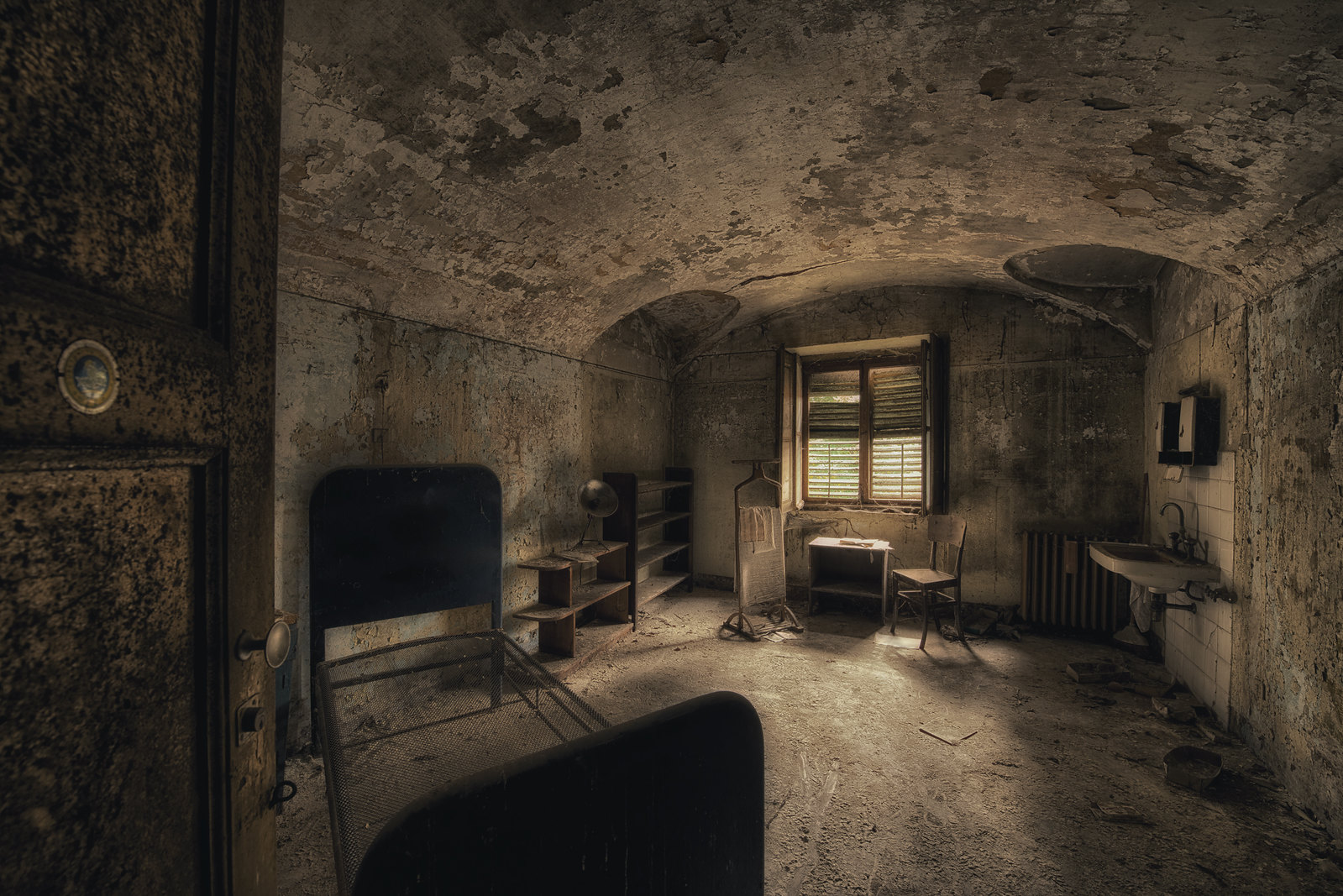 Doctor's bedroom in an abandoned Psychiatric Hospital in ...