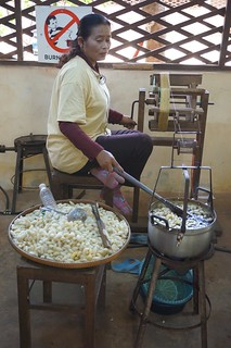 Cocoons go into hot water to be unraveled