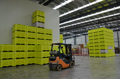 shipping container(0.0), yellow(1.0), warehouse(1.0), forklift truck(1.0), factory(1.0),
