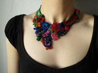 colorful freeform crochet bib necklace - statement necklace with red, purple, pink, blue, gray and green beaded crochet flowers by irregular expressions