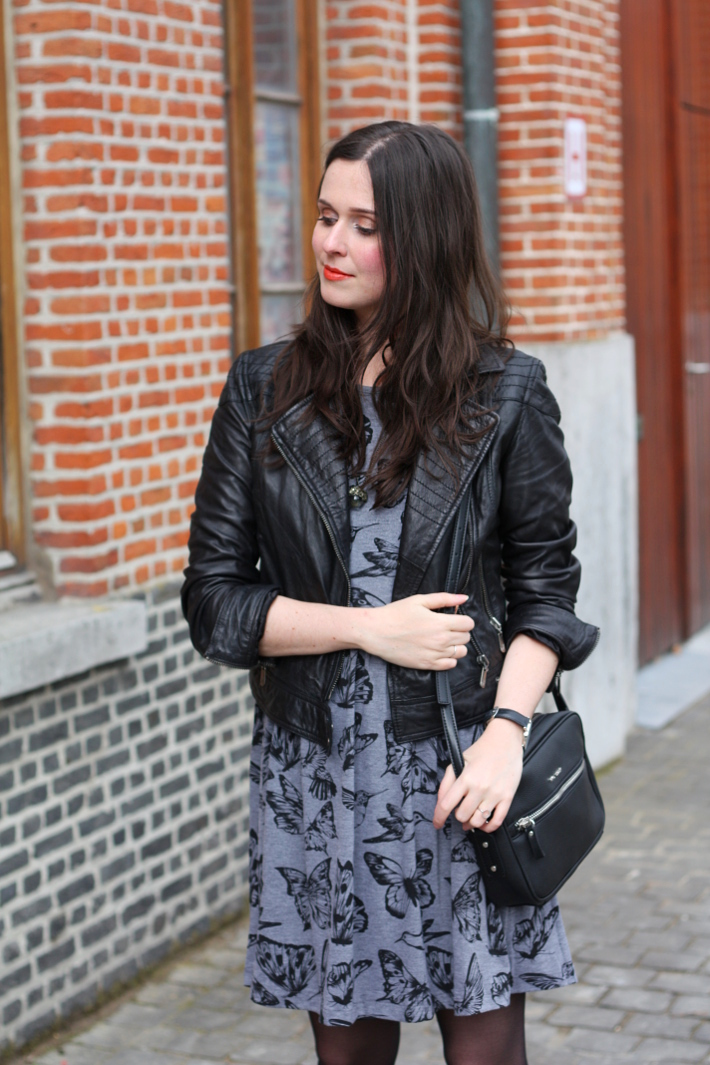 outfit: leather jacket, butterfly print dress