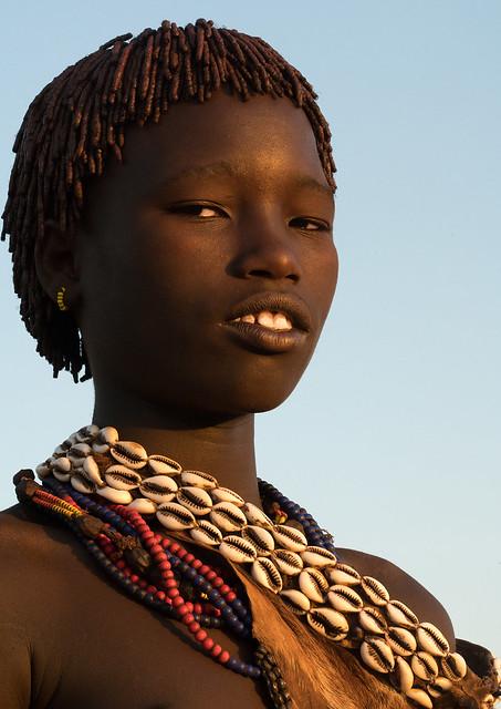Portrait of a hamer tribe teenage girl, Omo valley, Turmi, Ethiopia