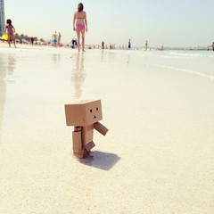 Danbo: What's this? John: We're on the #beach. Don't get far or you'll drown! #danboard first day out on the beach. #jbr #dubai