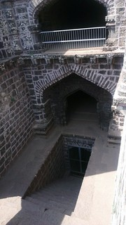 Andhar Bav (Dark Well) camouflaged under stone arches