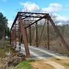 Abiaca Creek through-truss bridge was built in 1930 and is located in Carroll County, MS. It's a Pratt through truss with a wooden deck that's open to light traffic.