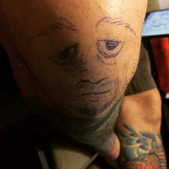 Robert was distracted today so I drew a face on his knee. It was funny at the time but now it's watching me.