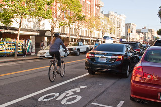 22623 Passing four deep parking dirty in southbound Polk St. bike lane after Green