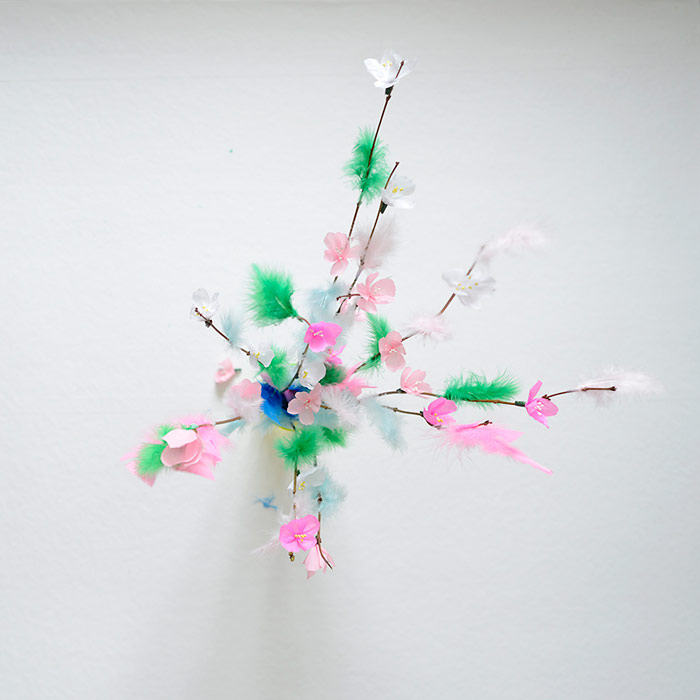 Easter twigs decorated with feathers and paper cherry blossoms