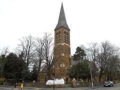 A brick-built church with a sturdy grey spire.
