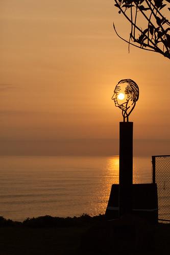 ocean sunset sea sculpture sun art peru southamerica water canon surf shadows pacific lima silhouettes pacificocean oranges yellows swell miraflores settingsun peruviantourism peruvianphotography geraintrowlandlima sunsetsinsouthamerica beautifulskyandsea