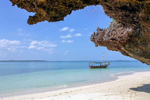 africa travel tourism beach landscape tanzania island coast boat traditional lagoon coastline zanzibar emerald touristattraction lunchbreak eastafrica traditionalboat emeraldsea emeraldisland safariblue