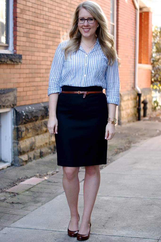 blue blouse with a black pencil skirt