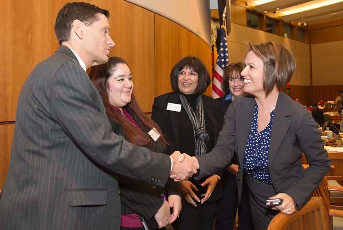 State Representative Stephanie Garcia-Richard (far right) greets Kurt Steinhaus, Los Alamos National Laboratory's Community Programs Director, at the State Capitol. Also pictured (left to right) are Bridgett Alvarez of the Public Service Company of New Mexico, Liz Shipley of Intel and Valerie Salim-Meza of Sandia National Laboratories.