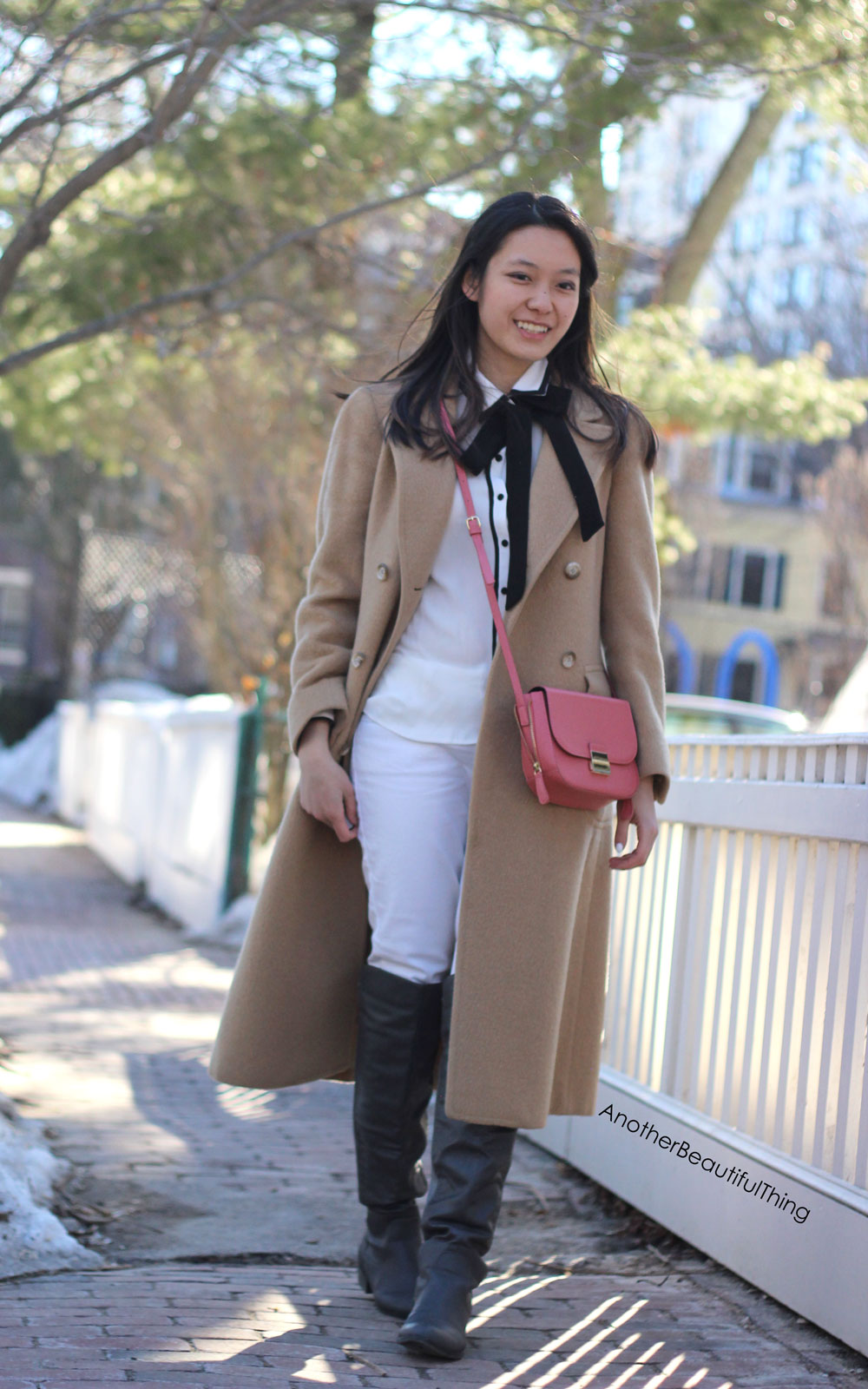Camel coat and black neck bow tie