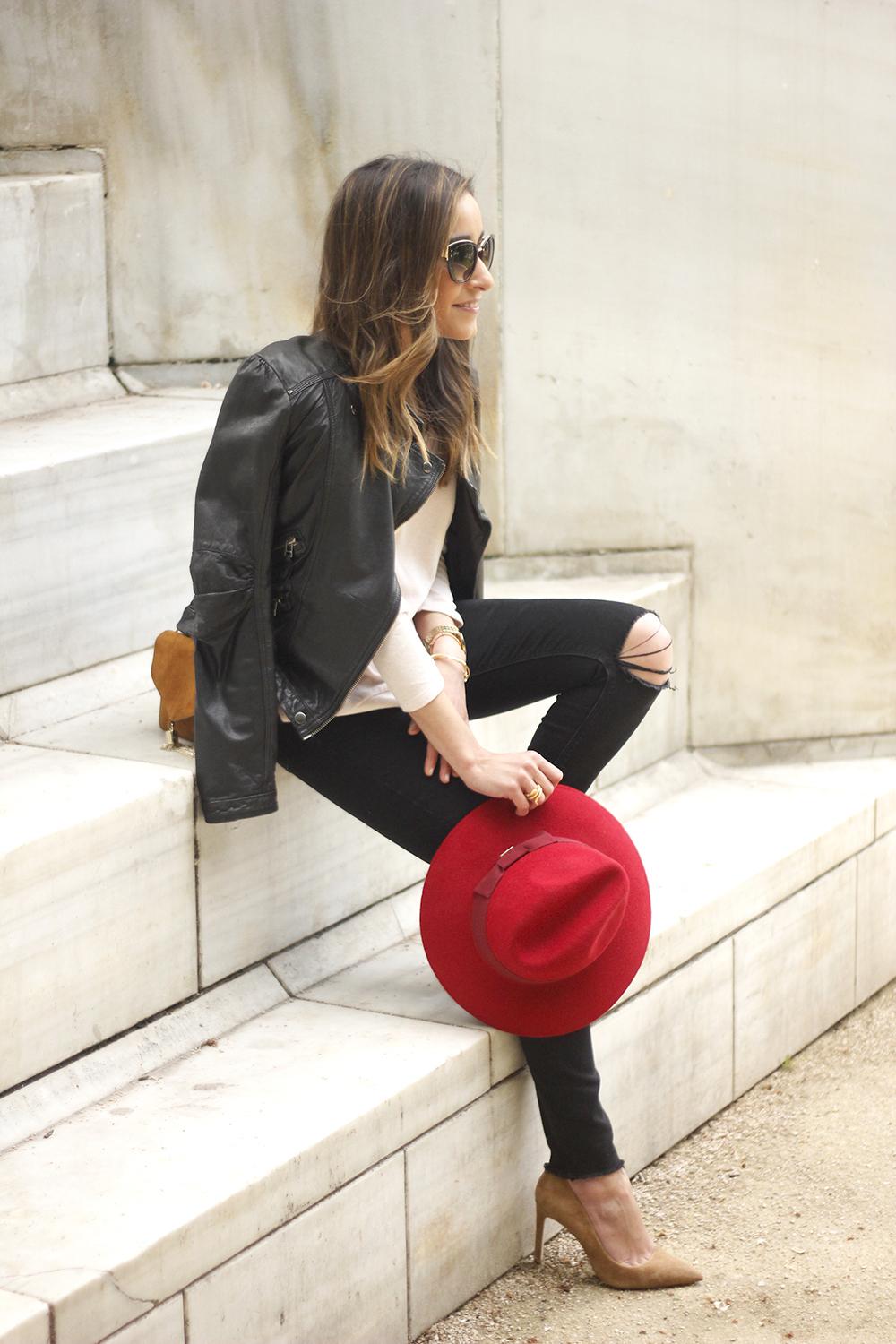 black biker jacket ripped jeans red hat camel bag outfit fashion style spring01