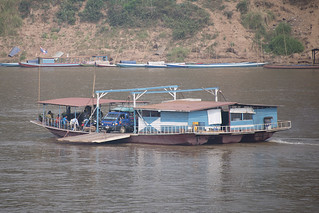 Boat ferrying people and vehicles across the Mekong River, Luang Prabang, Laos