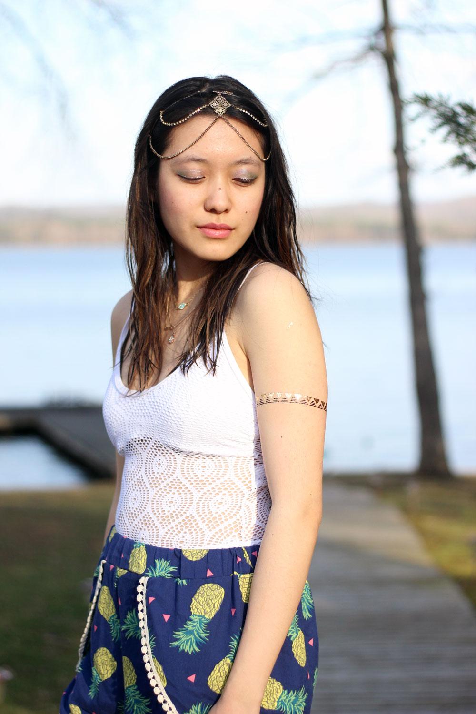 White crochet swim suit and pineapple print shorts with mini pom poms