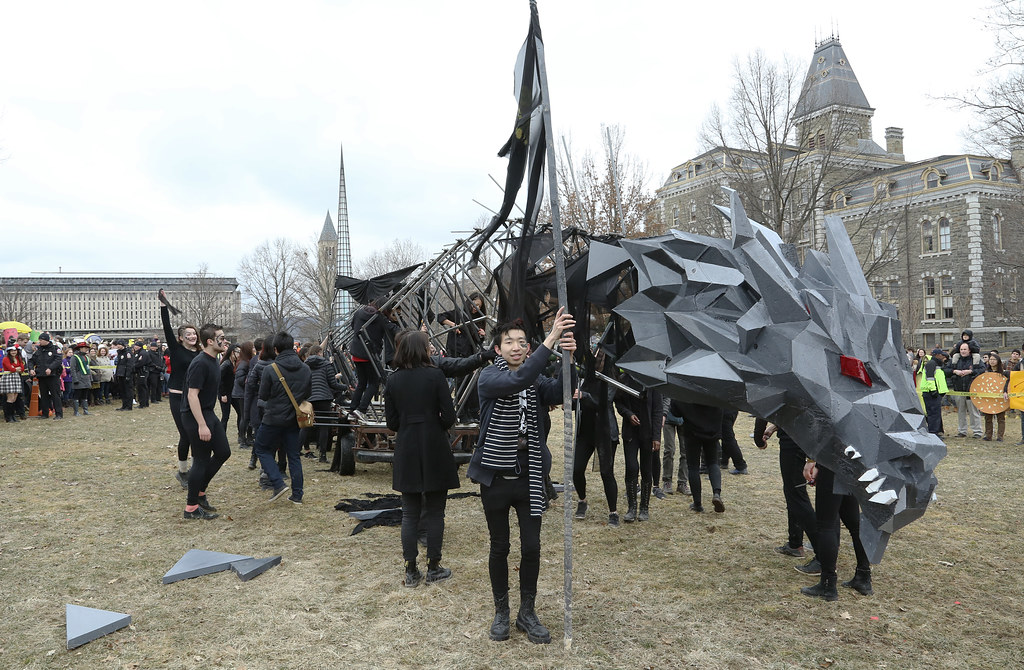 First-year students celebrate as the 2015 dragon comes to rest on the arts quad.