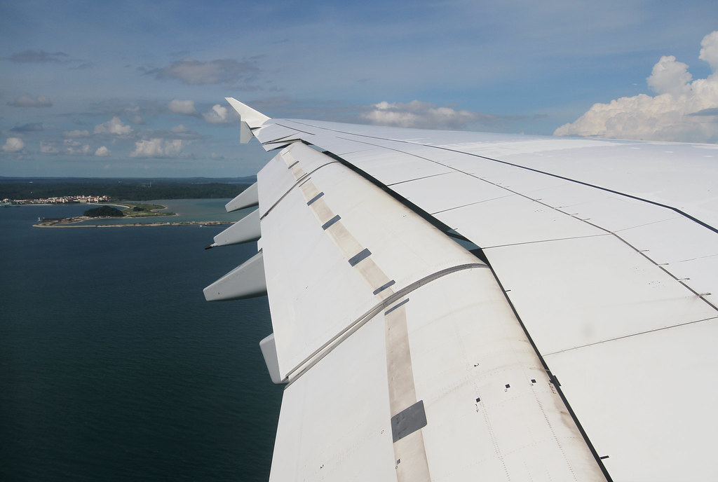 Short final for RWY20R into Singapore Changi after a flight from Frankfurt. In the distance is Tekong Island, Singapore's second largest island. Aircraft delivered 05/2010