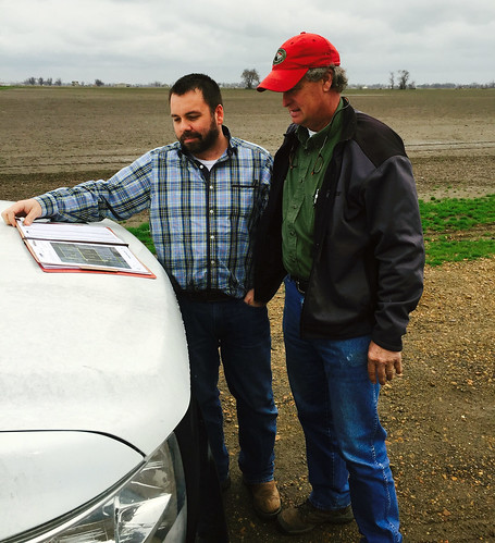 Fred Stuckey, of Stuckey Farms Partnership, reviews his conservation plan with Chris Culver, the local NRCS district conservationist in Poinsett County. NRCS photo.