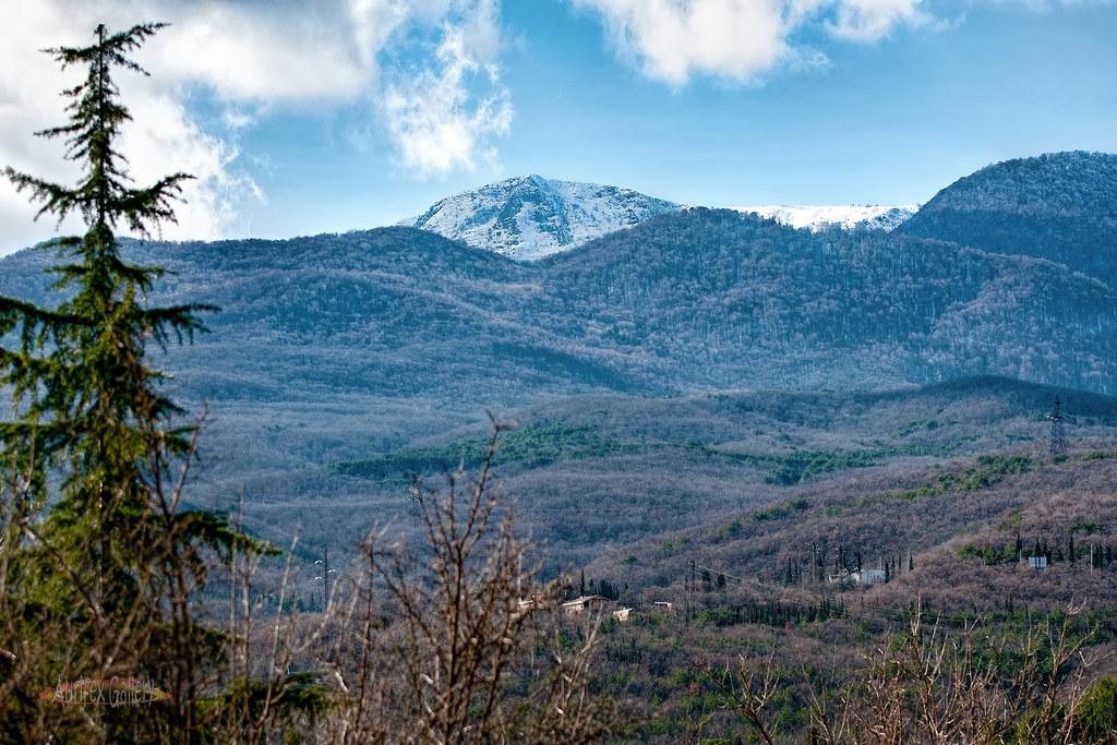 Mountain peaks strewn with Snow II