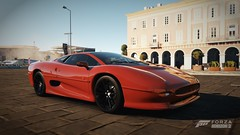 ferrari f355(0.0), lamborghini diablo(0.0), race car(1.0), automobile(1.0), vehicle(1.0), performance car(1.0), automotive design(1.0), jaguar xj220(1.0), land vehicle(1.0), luxury vehicle(1.0), supercar(1.0), sports car(1.0),