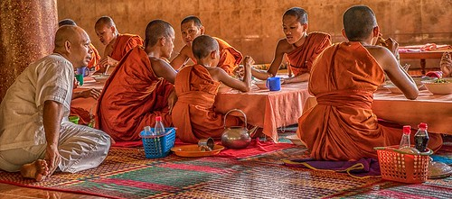 Monks eating lunch - Cambodian temple