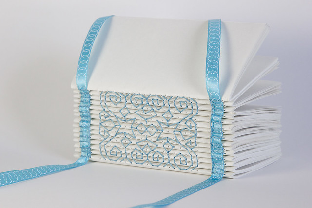 IMG_3490-White Book with Blue Ribbon on White Background