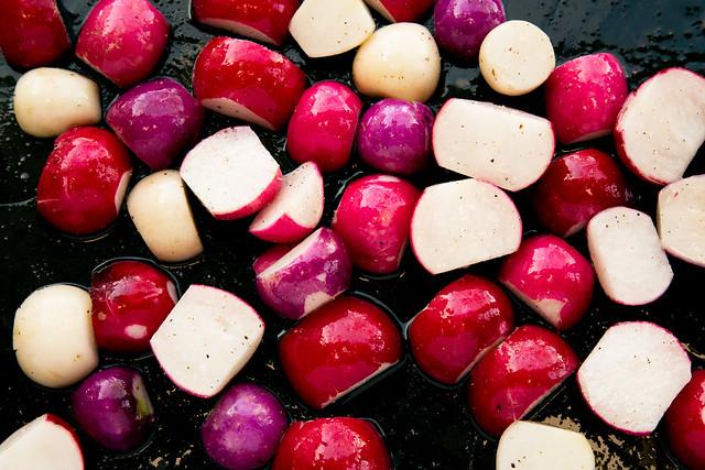 cut radishes on roasting pan
