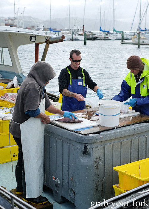 Fishmongers on the boat at Harbourside Market, Wellington