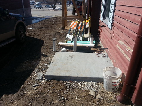 Concrete pad awaits heat pump/air conditioner